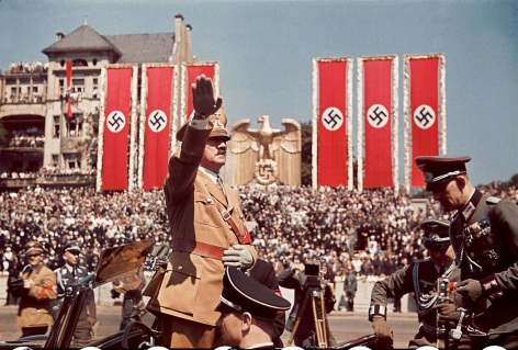 Adolf Hitler salutes troops of the Condor Legion who fought alongside Spanish Nationalists in the Spanish Civil War, during a rally upon their return to Germany, 1939..jpg